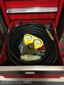 Air tool drawer with hose and regulator